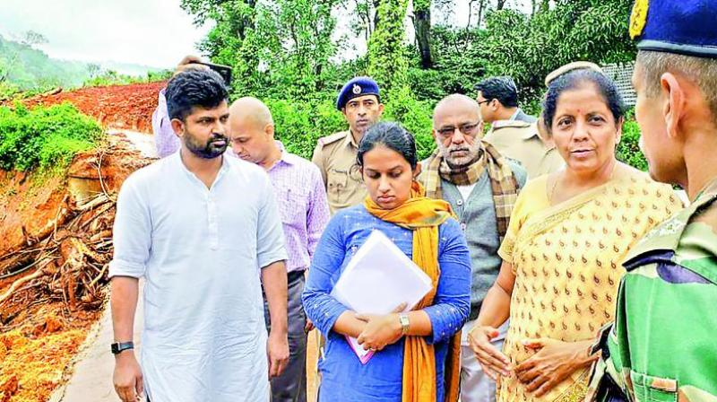 Defence minister Nirmala Sitharaman reviews the situations in flood-affected areas, in Kodagu on Friday. (Photo: PTI)