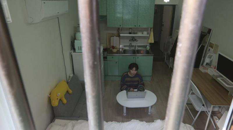 Kim Da-hye, a 29-year-old South Korean, sits with her laptop computer in her semi-basement apartment in Seoul, South Korea. AP photo