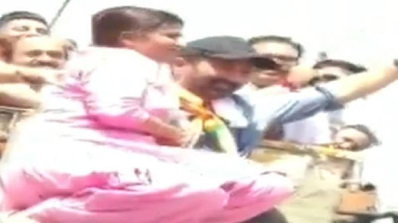 The woman climbed on the Deol's vehicle to kiss Sunny Deol. (Photo: ANI)