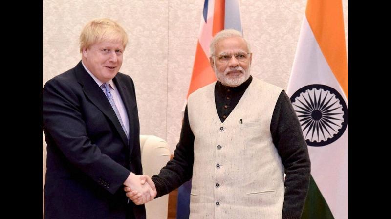Prime Minister Narendra Modi with British Prime Minister Boris Johnson. (Photo: File/PTI)