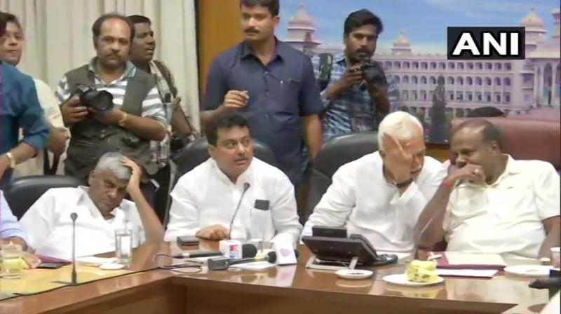Asserting that all their MLAs were with them, Deputy CM G Parameshwara said the coalition would continue under Kumaraswamy's leadership and that there was no threat to the government. (Photo: ANI)