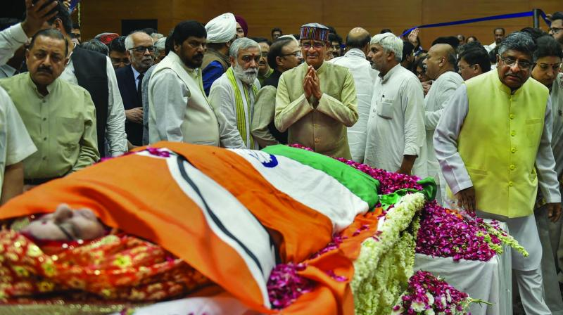 BJP vice-president Shivraj Singh Chouhan pays his last respects to former external affairs minister Sushma Swaraj at BJP headquarters in New Delhi on Wednesday. (Photo: PTI)