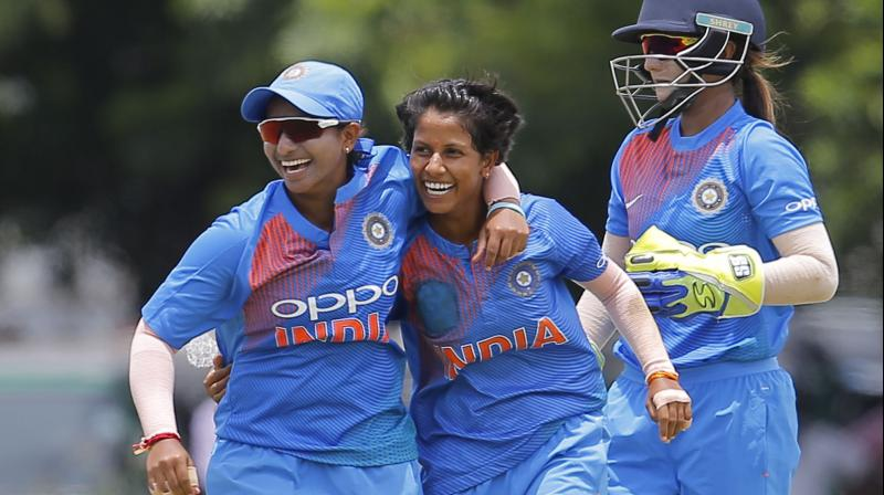 Poonam Yadav (centre) being congratulated by a teammate after taking a wicket against Sri Lanka. AP Photo