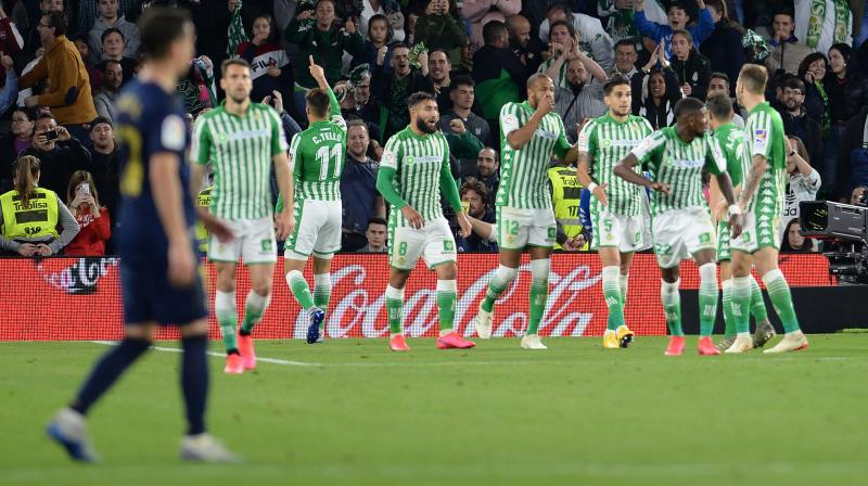 Cristian Tello (3rd from left) celebrates his goal with his teammates as Real Betis handed Ral Madrid one of their biggest defeats in La Liga this season at the Benito Villamarin Stadium in Seville on Sunday. AFP Photo