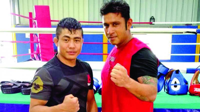 Roshan with coach Vishal