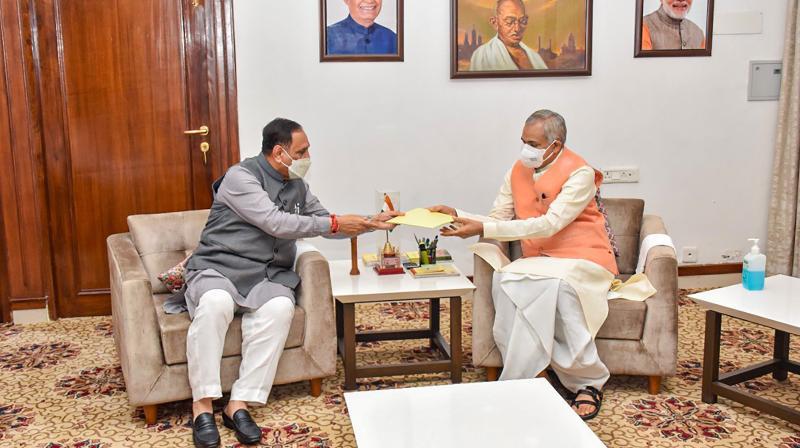 Gujarat Chief Minister Vijay Rupani submits his resignation letter to Governor Acharya Devvrat at Raj Bhavan in Gandhinagar, Saturday, Sept. 11, 2021. (PTI)