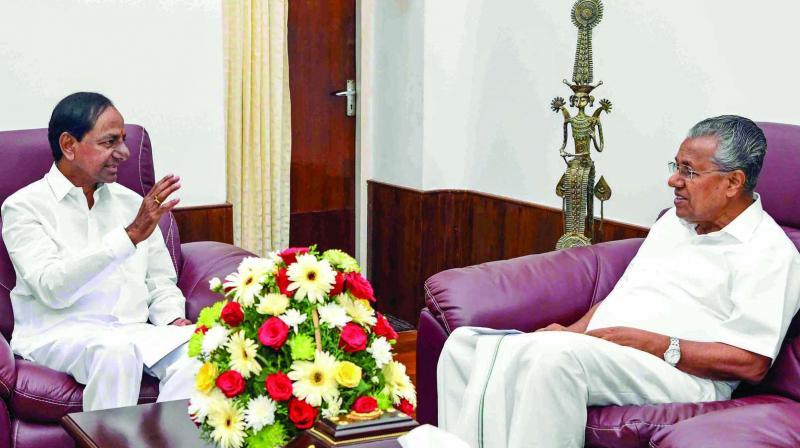 Telangana chief minister K. Chandrashekar Rao meets his Kerala counterpart Pinarayi Vijayan at the latter's residence in Thiruvananthapuram on Monday. (Photo: PTI)