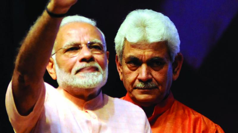 PM Narendra Modi with MoS Manoj Sinha during the launch of India Post Payments Bank in New Delhi on Saturday. (Photo: G.N. JHA)