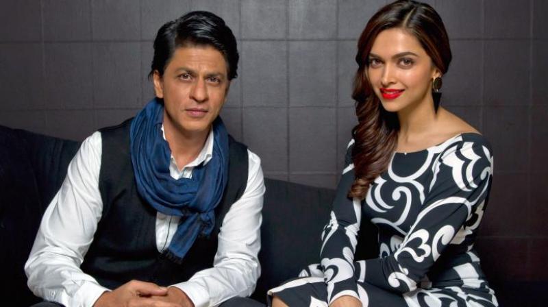 Shah Rukh Khan and Deepika Padukone at an event.