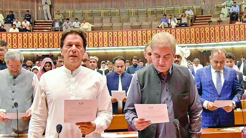 Newly-elected parliamentarian Imran Khan takes the oath of office in Islamabad, Monday. (Photo: AP/PTI)