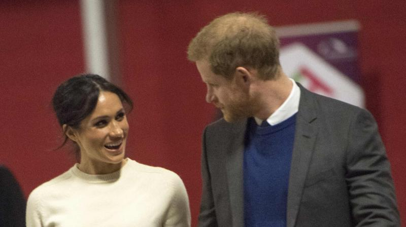Britain's Prince Harry and US actress and fiancee of Britain's Prince Harry Meghan Markle arrive at the Eikon Centre in Lisburn, on March 23, 2018. (Photo: AFP)