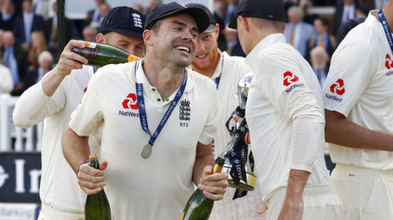 England's James Anderson celebrates with the team after winning the test series against the West Indies at Lord's cricket ground in London. (Photo: AP)