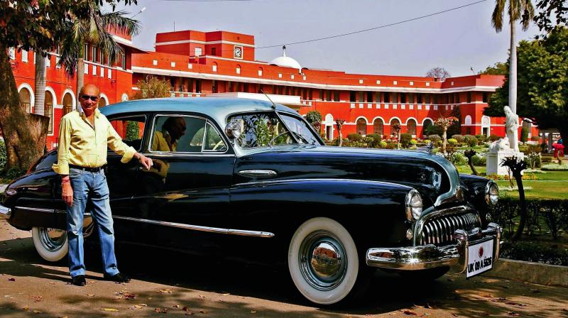 Manujendra Shah of the erstwhile princely state of Tehri-Garhwal is seen with a 1947 Buick in New Delhi. The vintage car was recently sold by him. (Photo: PTI)