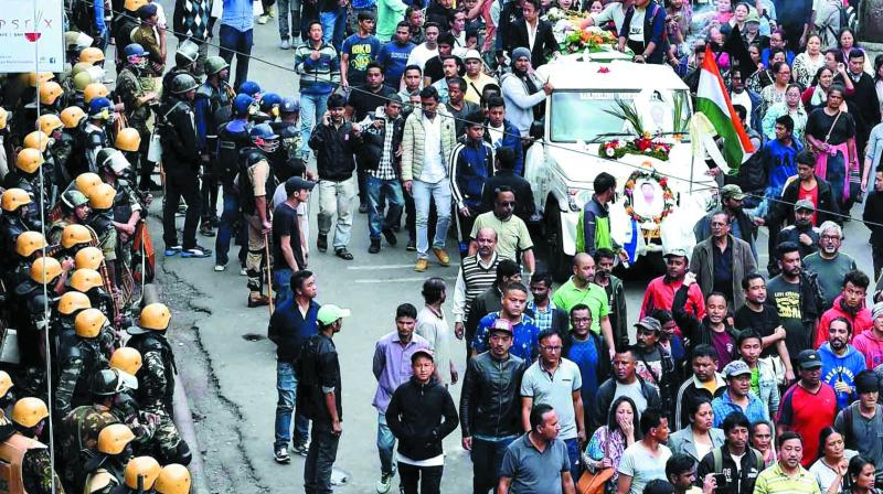GJM activists in Darjeeling on Sunday take out the funeral procession of party activists who died Saturday. (Photo: PTI)