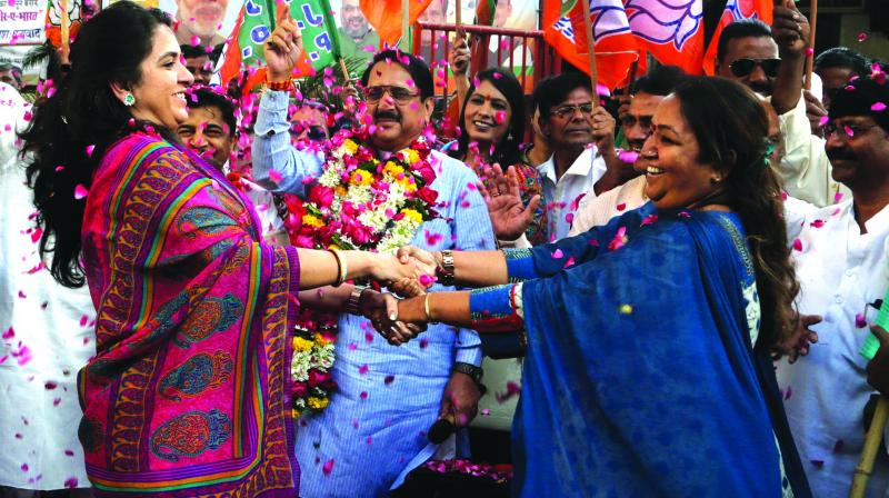 A file photo of BJP supporters celebrating the passage of the Bill for 10 per cent EWS quota in Parliament.
