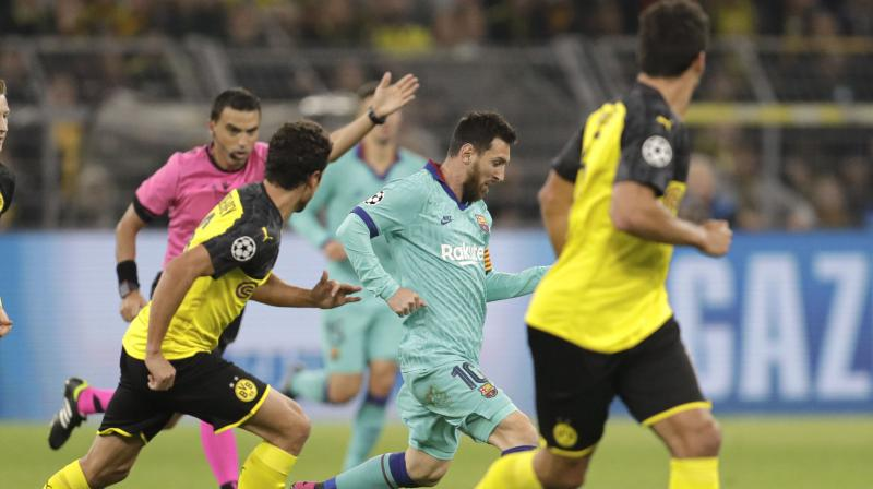 Borussia Dortmund hit the woodwork and had a penalty saved before drawing 0-0 with Barcelona in their Champions League Group F opener on Tuesday, with Lionel Messi making his first appearance of the season for the Spaniards. (Photo:AFP)