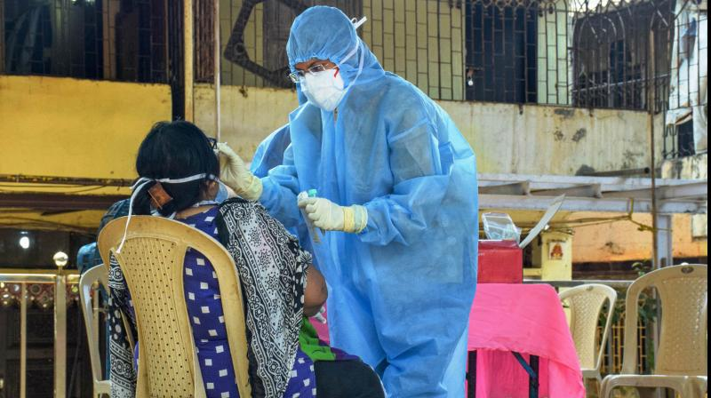 A medical official checks a patient to ensure the possibilities of COVID-19 disease during a nationwide lockdown, imposed in the wake of coronavirus pandemic.  (PTI)