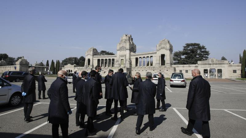 In this March 17, 2020 file photo, pallbearers stand outside the Monumentale cemetery in Bergamo, the heart of the hardest-hit  Italy's hardest-hit region of Lombardy, Italy.(AP)