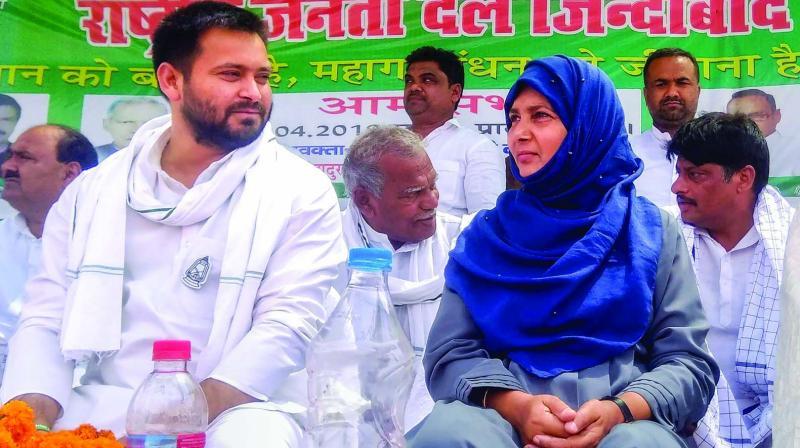 Hina Shahab, Rashtriya Janta Dal Lok Sabha candidate from Siwan and wife of convicted leader Mohammed Shahabuddin, with party leader Tejashwi Yadav during an election campaign rally in Siwan on Sunday.  (Photo: PTI)