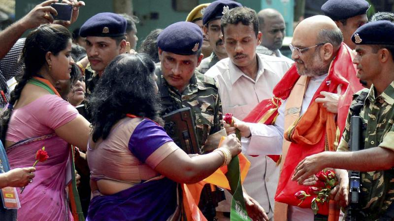 BJP chief Amit Shah meets party workers during the party workers' conference in Bhubaneswar. (Photo: PTI)