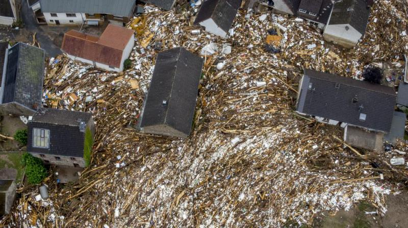 Debris of houses and trees surround houses in Schuld, Germany, Friday, July 16, 2021. Two days before the Ahr river went over the banks after strong rain falls causing severals deaths and hundreds of people missing. (AP)