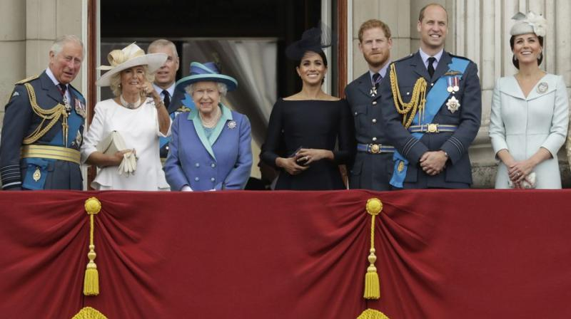 In this Tuesday, July 10, 2018 file photo, members of the royal family gather on the balcony of Buckingham Palace, with from left, Prince Charles, Camilla the Duchess of Cornwall, Prince Andrew, Queen Elizabeth II, Meghan the Duchess of Sussex, Prince Harry, Prince William and Kate the Duchess of Cambridge, as they watch a flypast of Royal Air Force aircraft pass over Buckingham Palace in London.  AP photo