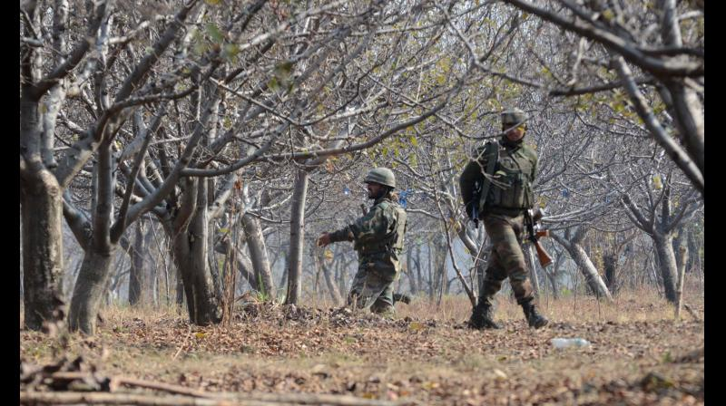 Security Forces in action during encounter in Futlipora village of Pakharpora in central Kashmir's Budgam district. (Photo: H U Naqash)