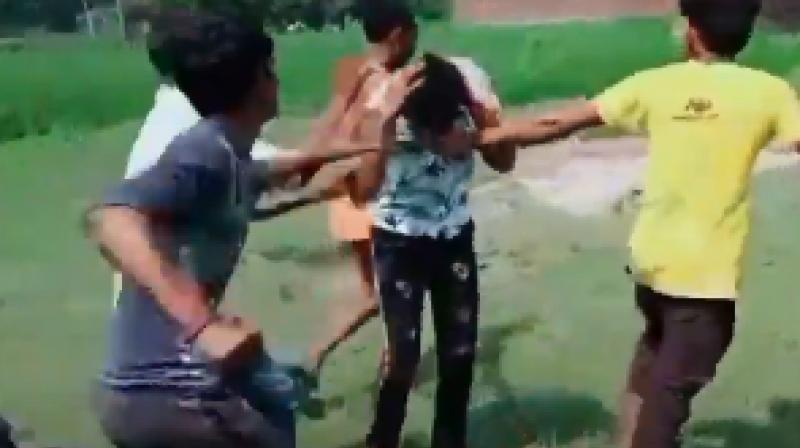 One of the three men was cornered by the locals and almost beaten to death. (Photo: Social Media)