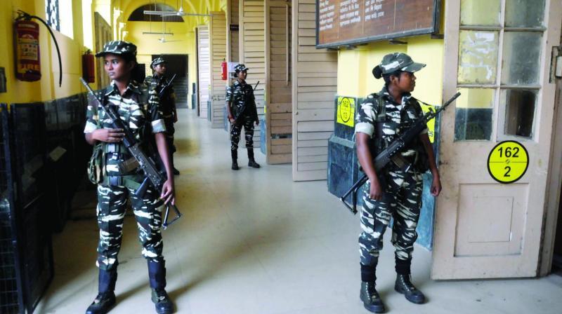Women CRPF personnel deployed in a polling booth IN Kolkata on Saturday. (Phgoto: Abhijit Mukherjee)