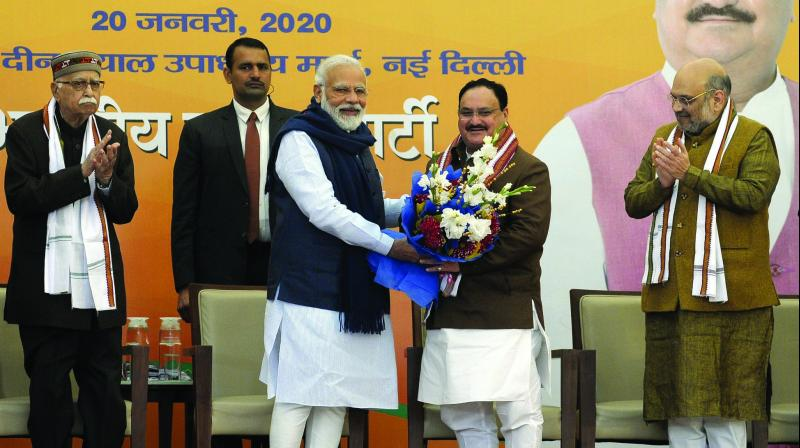 Prime Minister Narendra Modi greets newly-elected BJP president J.P. Nadda at the BJP HQ in New Delhi on Monday. Veteran party leader L.K. Advani and Union home minister Amit Shah are also seen. (Photo: PTI)