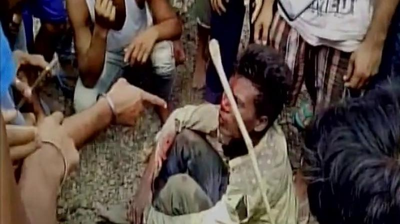 The mob continuously thrashed them with sticks while chasing them for about 1.5 km. (Photo: ANI Twitter)