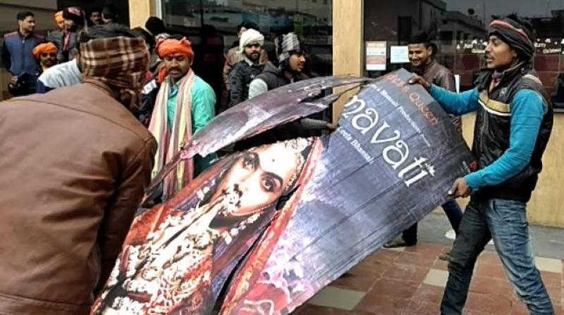 Violent protests by members of the Rajput community against the release of Sanjay Leela Bansali's controversial period drama 'Padmaavat' were witnessed across Gujarat on Sunday, with agitators damaging buses and blocking roads. (Photo: PTI)