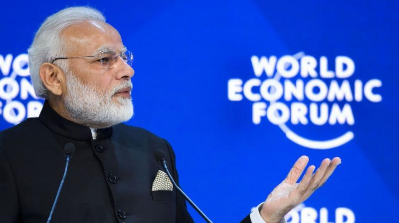 PM Modi delivers his speech as Klaus Schwab, Founder and Executive Chairman of the World Economic Forum listens during the opening session of the World Economic Forum, WEF, in Davos, Switzerland. (Photo: AFP)