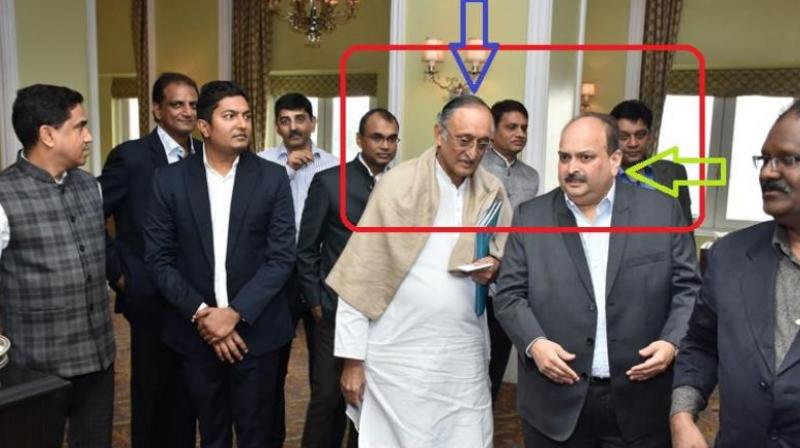 West Bengal BJP released photographs of state Finance Minister Amit Mitra with founder of Gitanjali Gems Mehul Choksi who is on the run in the Punjab National Bank (PNB) fraud case. (Photo: Twitter | @DilipGhoshBJP)