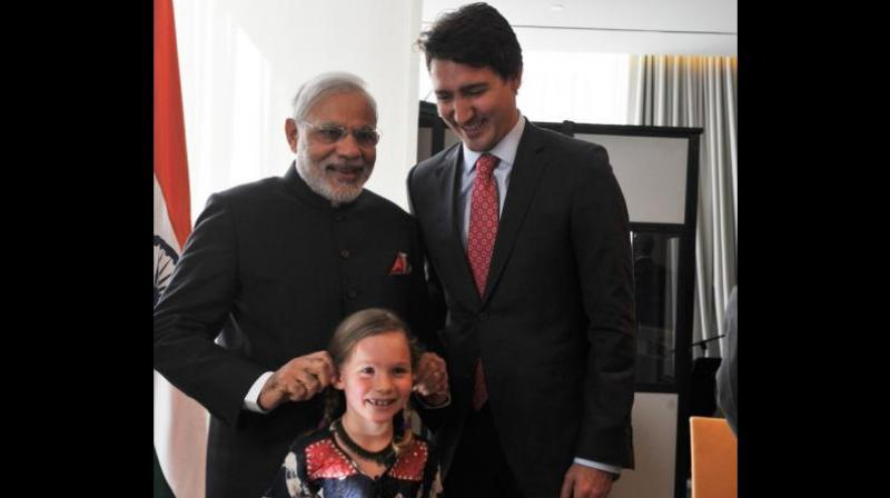 Prime Minister Narendra Modi tweeted a picture from his 2015 Canada visit, when he had met Canadian Prime Minister Justin Trudeau and his daughter Ella-Grace. (Photo: Twitter | @narendramodi)