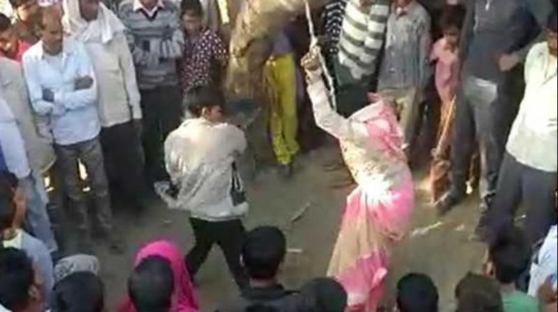 The video shows the husband beating the wife with belts and sticks and with every whip he was heard saying 'ab bhaag ke dikha (try to run away now)'. (Photo: ANI | Screengrab)