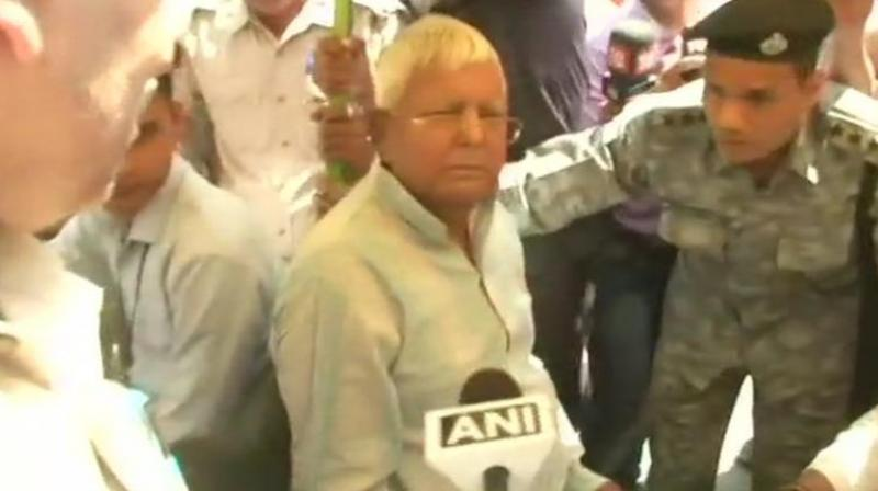 Lalu Prasad, who is serving jail term in Ranchi since December 23 in a fodder scam case, was taken to New Delhi on medical advice for specialised treatment at AIIMS. (Photo: ANI/Twitter)