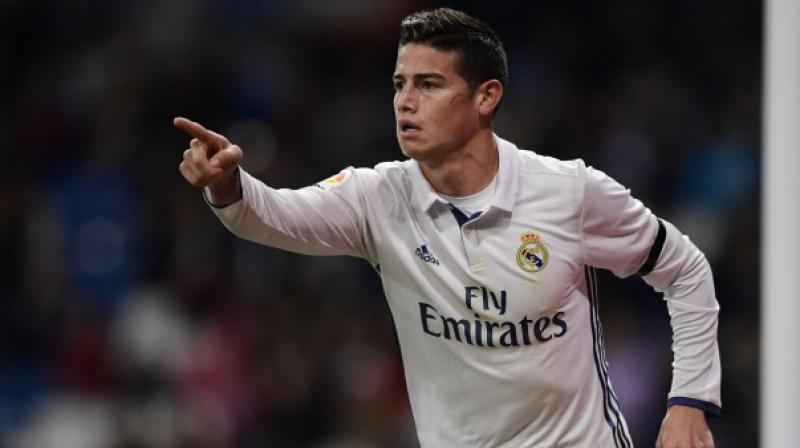 Real Madrid's Colombia midfielder James Rodriguez is likely to be out of action for the rest of the year after suffering a knee injury on international duty. (Photo:AFP)