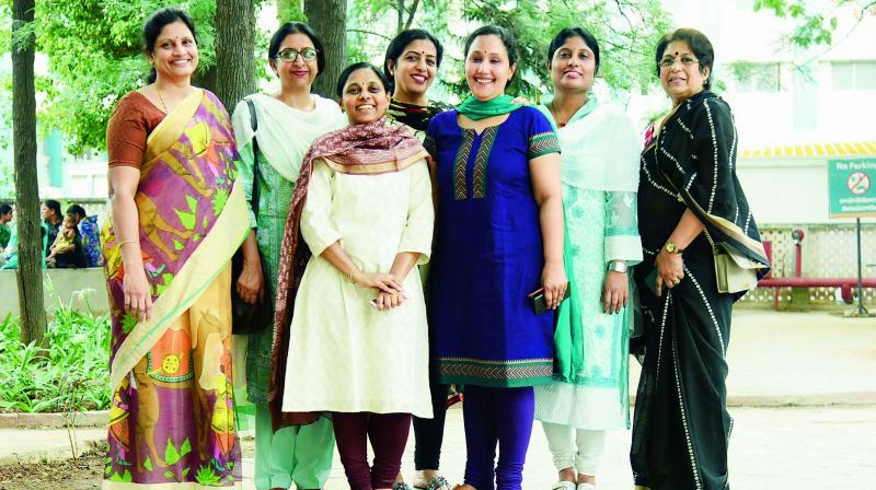 Swati, Shaila, Radhika, Durga, Shanti Vasuda and Santha John, with other group members.
