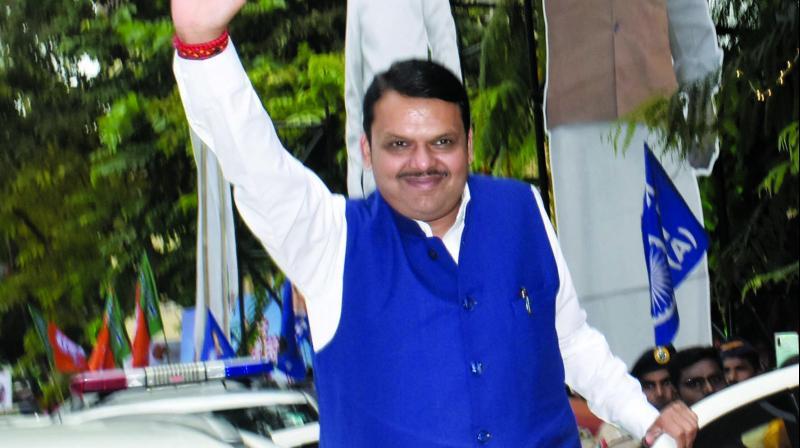 Maharashtra Chief minister Devendra Fadnavis celebrates his party's win in Assembly elections outside BJP head office in Mumbai. (Photo: Debasish Dey)