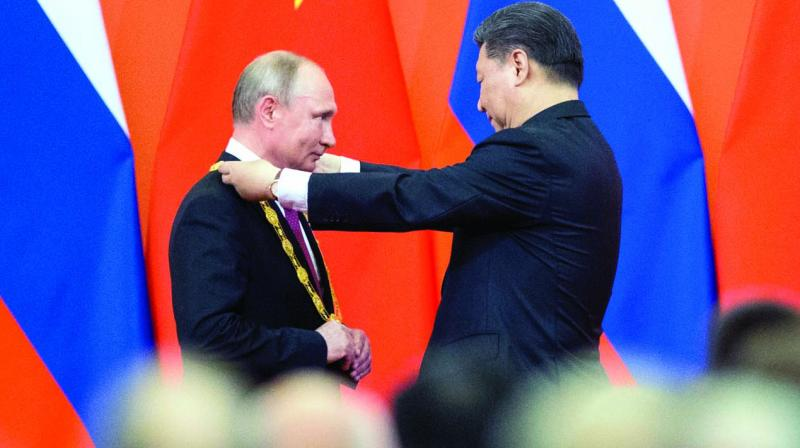 Russian President Vladimir Putin will hold talks with his Chinese counterpart Xi Jinping during an economic forum. (Photo: AP)