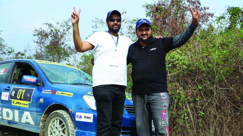 Ajgar Ali and Mustafa pose after defending the JK Tyre Himalayan Drive 7 crown on Saturday.