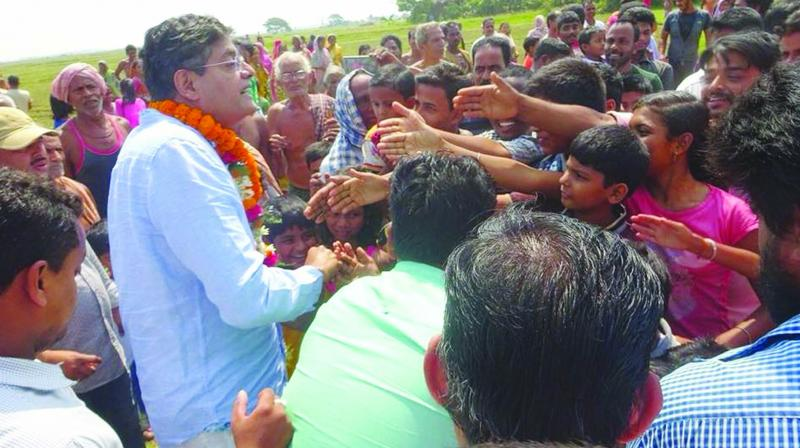 Former Biju Janata Dal leader Baijayant Panda interacting with voters in his constituency in a bid to maintain his hold over his supporters.