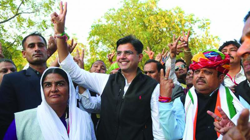 Rajasthan Congress chief Sachin Pilot and Congress candidate Raghu Sharma flash victory sign after the latter's victory in Ajmer Lok Sabha bypoll in February.