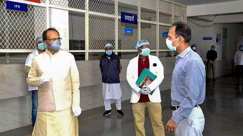 Madhya Pradesh chief minister Shivraj Singh Chouhan reviews the treatment facilities for coronavirus-affected patients at the Advanced Institute of Medical Sciences in Bhopal on March 28, 2020. (PTI)