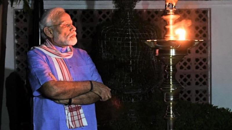 An image posted by prime minister Narendra Modi on his Twitter account after he lit a lamp as a symbol of the nation's battle against the coronavirus. (Twitter)