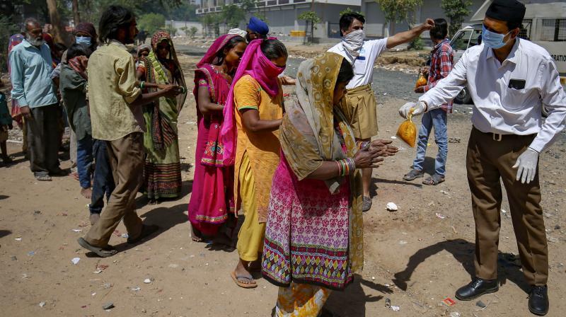 File photo of Rashtriya Swayamsevak Sangh (RSS) workers distributing food to people in Ahmedabad on March 29, 2020. (PTI)
