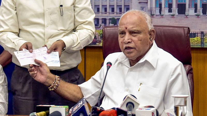 Karnataka chief minister B S Yeddyurappa (right) addresses a press conference after donating his salary to the Chief Minister Relief Fund on April 1, 2020. (PTI)