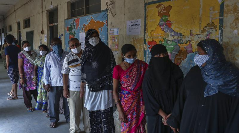 People line up to get inoculated against the coronavirus during a special vaccination drive held in the premises of a school in Hyderabad. (Photo: PTI)