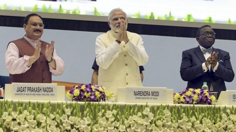 Prime Minister Narendra Modi during an event to launch Tuberculosis-Free India Campaign, to meet the goal of ending the epidemic by 2025, in New Delhi on Tuesday. Also seen are Health Minister JP Nadda and Nigerian Health Minister Isaac Adewole. (Photo: PTI)